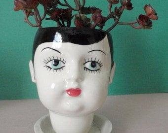 Eden doll head planter