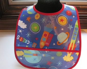 WATERPROOF WIPEABLE Baby to Toddler Wipeable Plastic Coated Bib Rockets in Space