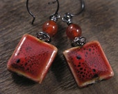 Red porcelain and stone earrings, flat square beads, handmade rings with dyed jade and gunmetal black earrings
