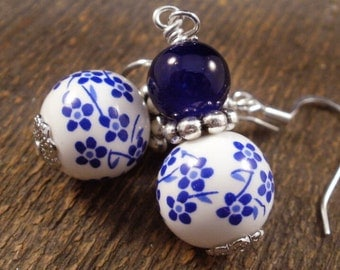 Royal blue flowers and white ceramic beads, glass and silver handmade earrings