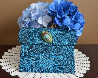 One of a kind envelope style corded pocket with brooch