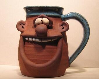 Happy Guy   Mug ........        Lefty ..............                      e880