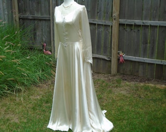 Circa 1940s white satin wedding gown dress with buttons on bodice, sleeves, snap side closure size 4 cathedral train