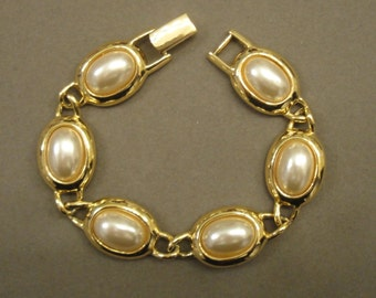 Vintage Napier gold tone metal and faux white pearl flexible link style bracelet, 7 inch wrist size, Classic in good condition