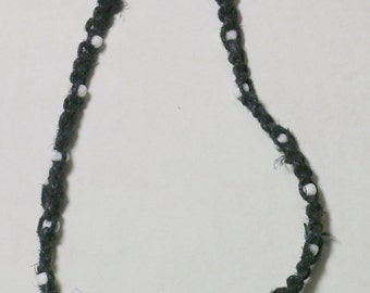 Black Hemp Adorned with Small White Glass Beads