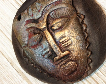 152. Wondrousstrange Raku African Mask Blue Cast Gold Red Rust Raku Pendant