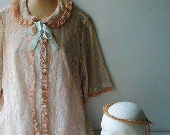 Luxurious vintage 50s beige- champagne lace , maxi ,A line robe with a pastel-blush blue accent. Made by Odette Barsa. Size Large.