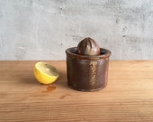 Handmade, wood fired citrus juicer by Julie Crosby