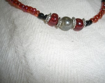 Silver center bead with red seed beads