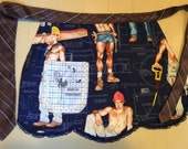 Hunks on this sexy apron. Fun apron with Where's My Drinkie Winkie. Buy this half apron to hostess your New Years Eve Party.  Hostess Gift