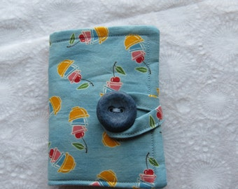 Tea Wallet in Yellow, Blue, and Pink Nesting Bowls with Cherries on Blue Tea Bag Holder