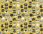 Spoonflower's Mustard Cat Faces fabric designed by Andrea Lauren - printed on a variety of cotton fabrics - by the yard