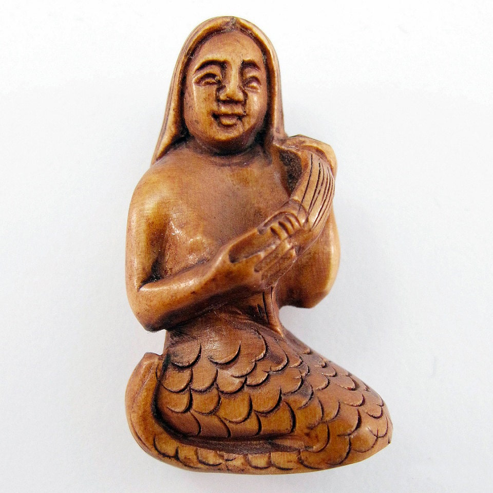 Mermaid combing her hair hand carved boxwood ojime bead