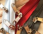 5mm Zipper Yardage: 9yds Beige, 10 yds Dark Gray, 6 yds. Red, 6 yds. Baby Blue & 28 Long Pulls