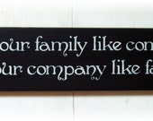 Treat your family like company and your company like family wood sign