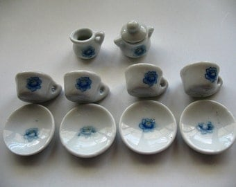 Miniature, Ceramic Tea Set in White with a Blue Floral Pattern. Miniature Cups and Saucers,with a Sugar and Creamer, 4 Mini Cups and Saucers