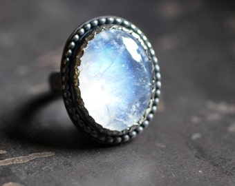 Oval Rainbow moonstone ring with pattern wire and beaded detail, size 7