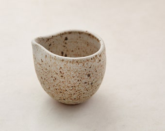 Wheel Thrown stoneware speckled small handleless  pitcher