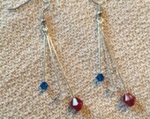 Red, white, and blue dangle earrings.