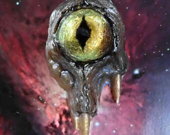 Gold color shifting resin cyclops pendant