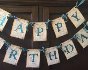 Happy Birthday Banner Garland. Aqua glitter die cut letters, crinkled seam binding ribbon.