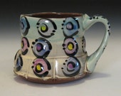fluted mug with circles purple lilac yellow green copper rutile