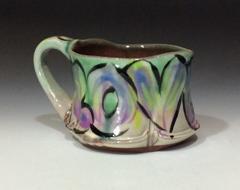 love mug with purple rutile tan copper green multi tones coffee tea water