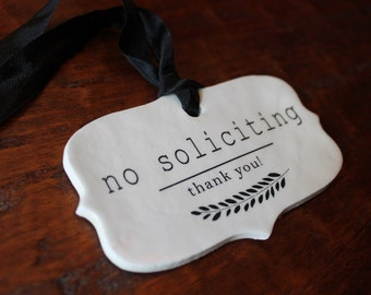 ceramic sign - no soliciting or do not disturb . choice of ribbon color