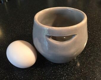 Grey ceramic egg separator