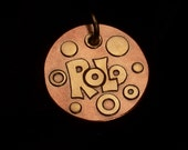 Brass and copper custom dog tag with bubbles