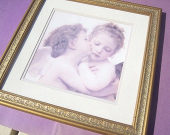 Hugging / Kissing Angels Framed Print