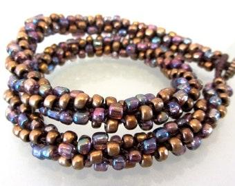 Knotted metallic glass bead bracelet