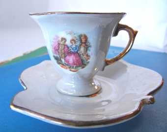 Miniature Teacup Collectible, Iridescent Finish with Stars, Ivy Motif, and Pastoral Scene, Made in Japan