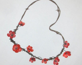 Barbed Wire Heart With RedForever Blooming Flowers