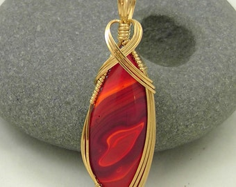 Red Art Glass Pendant wrapped in Brass