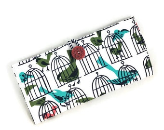 Cheque storage cover with bird cage print