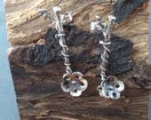 Sterling silver  twig style earrings with hand pierced flowers. Hallmarked