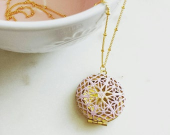 Blush filigree locket with personalized brass bar on gold dotted chain, modern personalized jewelry
