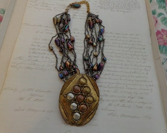Vintage  wild mixed media necklace,  beads, chain and brass focal piece