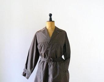 40% OFF SALE // Vintage raincoat. 1970s trench raincoat. 70s deadstock rain belted jacket