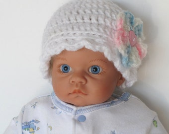 Crocheted White Doll Cap With Pink and Blue Flower