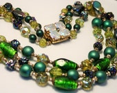 Vintage green glass bead necklace. 3 strand necklace.  3 row necklace