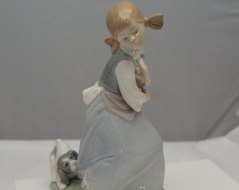 LLadro Naughty Dog 1978 #4982 Girl with puppy pullling on Skirt Vintage Figurine pigtailed and adorable