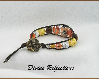 Boho Leather Wrap Bracelet,Tan Artisan Focal Bead, Yellow, Orange and Brown Accent Beads, Antique Gold Flower Clasp