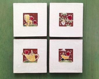 "Red Birds in the garden Set of 4 coasters handmade ceramic tiles 4""x4"" yellow resort chair, watering can, birdhouse, wheelbarrow"