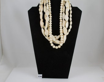 Vintage Off White 5 strand Beaded Necklace, Strung on string. Large elongated beads and round beads.
