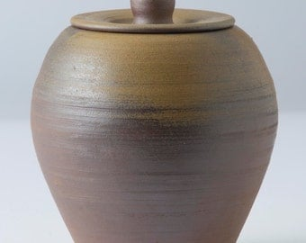 Wood-fired ceramic jar with lid.