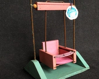 Antique pink swing lounger for the doll house. Miniature collectible retro toy.