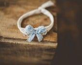 Pastel blue bow tie back Headband