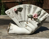 Vintage porcelain hand painted hand holding flowered fan